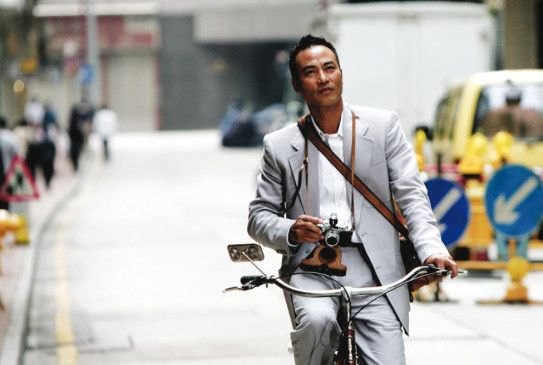 Noch scheint die Welt für Taschendieb Kei (Simon Yam) in bester Ordnung