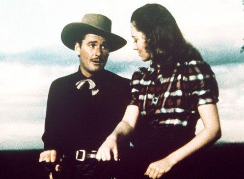 Die hübsche Abbie (Olivia de Havilland) ist sehr angetan von Wade Hatton (Errol Flynn)