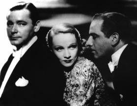Tja, wen nehm ich denn jetzt? Marlene Dietrich  zwischen Herbert Marshall (l.) und Melvin Douglas