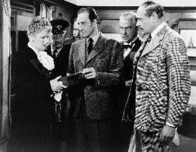 Einer kniffligen Lösung auf der Spur: Basil Rathbone (Mitte) als Holmes