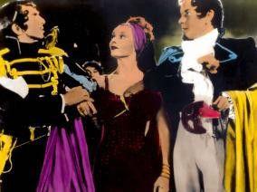 Das ist aber ein buntes Treiben! Leonide Massine, Ludmilla Tscherin und Robert Rounseville (v.l.)