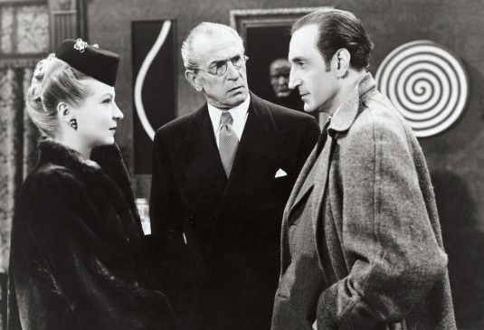 Kombiniere, kombiniere... - Basil Rathbone (r.) als Sherlock Holmes
