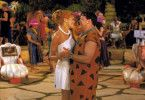 Fred (Mark Addy, re.) und Wilma (Kristen Johnston, li.) genießen ihren Tanz... Foto: © 2000 Universal Studios and Amblin Entertainment, Inc. All Rights Reserved. FOR EDITORIAL USE ONLY -- NOT FOR RESALE -- DO NOT ARCHIVE