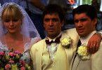 Tony (Al Pacino) mit seiner frisch angetrauten Ehefrau Elvira (Michelle Pfeiffer) und seinem besten Freund Manny Ray (Steven Bauer).