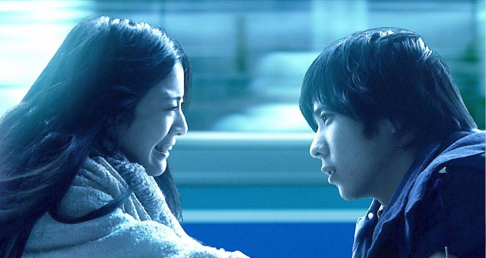 Masaru Kato (Ken'ichi Matsuyama,r.) und Tae Kojima (Yuriko Yoshitaka).