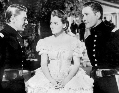 George (Ronald Reagan, l.) und Jeb (Errol Flynn) begehren beide die schöne Kit (Olivia de Havilland)